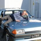 Motoring enthusiast Johnny Dennis and his 1983 Ford Falcon XE wagon. Photo: Ashleigh Martin