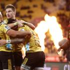 Ben Lam of the Hurricanes scores a try and is congratulated by Jordie Barrett during the Super...