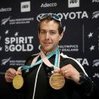 Otago skier Adam Hall at Auckland Airport yesterday with the gold and bronze medals he won at the...