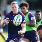 Reece Hodge gets a pass away at a recent Rebels training session in Melbourne. Photo: Getty