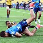Melani Nanai of the Blues defends in the try line against Julian Savea of the Hurricanes. Photo:...