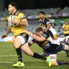 Nehe Milner-Skudder runs the ball during the match between the Brumbies and the Hurricanes in...