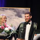 Logan Wallace, supported by partner Penny Hicks, soaks up the win after being crowned the 2018...