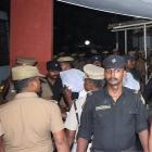 Police escort one of the men (face covered) accused of raping a 12-year girl inside the high...