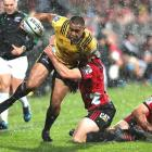 Hurricanes winger Julian Savea is tackled during the side's last meeting with the Crusaders....