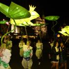 Frogs and lilies enchant the crowd at the Dunedin Midwinter Carnival