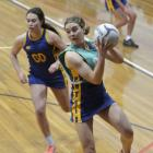 Phys Ed A's Laura Moffatt takes a pass in front of Phys Ed B's Meg Timu during their premier club...