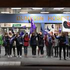 Striking nurses form a picket line in front of Dunedin Hospital on Thursday morning. Photo:...