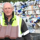 Waitaki Resource Recovery Trust manager Dave Clare holds a composite Roman roofing tile made in...