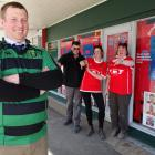 Maheno rugby player and Kurow resident Andrew Fisher is goaded by Kurow supporters (from left)...