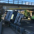 The truck on its side after it collided with an overbridge in Oamaru. Photo: Daniel Birchfield