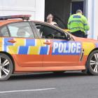 A victim of a road-rage attack in North Dunedin yesterday afternoon speaks to police in Duke St....