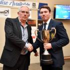 Otago Daily Times group sales manager Paul Dwyer (left) presents Josh Casey with the Dunedin...