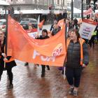Dunedin PSA members move through the Octagon yesterday during a march in support of better pay....