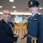 Defence Minister Ron Mark presents Pilot Officer George Bellamy with the Baigent Memorial Shield....
