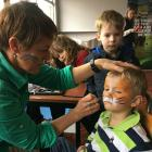 Charlie Johnstone (3), of Ashburton, gets his face painted like a tiger by Jo Knighton, of...