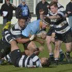 University hooker Kilipati Lea is caught from behind by Southern prop Jone Lesi as Southern...