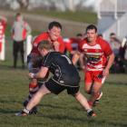 Clutha No8 Rym Geary powers through the tackle of Clinton flanker Greg Landels, as Kurt Turnbull...
