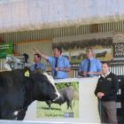PGG Wrightson livestock genetics rep Callum McDonald (left), auctioneer John McKone (centre) and...