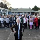 Stand chief executive Fiona Inkpen in front of a crowd of visitors and staff in the main...