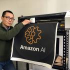 Happy Moose founder Alex Dong checks the knife on a cutter creating a dot decal for electronic...