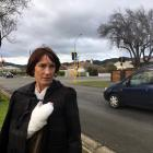 Mosgiel-Taieri Community Board chairwoman Sarah Nitis watches traffic negotiate Inglis St in...