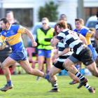 Taieri midfield back Kori Rupune heads for the tryline chased by Southern defenders (from left):...