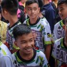 The 'Wild Boars' soccer team arrive for a press conference for the first time since they were...