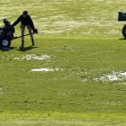 Groundsman Yannis Warrender operates a debris bowler yesterday while Metropolitan Rugby Council...