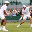 Raven Klaasen of South Africa and Michael Venus of New Zealand play at Wimbledon. Photo: Getty...
