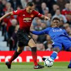 Manchester United's Matteo Darmian (left) tries to evade the challenge of Leicester City's...