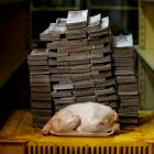 A 2.4 kg chicken is pictured next to 14,600,000 bolivars, its price and the equivalent of 2.22...