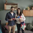 Prime Minister Jacinda Ardern and partner Clarke Gayford relax in the living room of their...