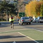 A cyclist on the State Highway 1 cycleway and a truck on State Highway 88  between Dunedin and...