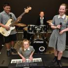 Tawhaki rock group members bass guitarist Harmony Oto, keyboard player Aimee Jenkins, drummer...