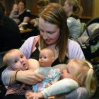Beki Forbes feeds her children Addison (2 years) and a more reluctant Clarabelle (6 months) at a...