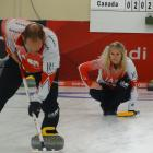 Canada's Jennifer Jones keeps a close eye on the direction of her throw as partner Brent Laing...