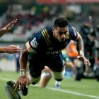 Highlanders flanker Shannon Frizell scores a try as Blues first five-eighth Bryn Gatland closes...