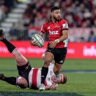 Richie Mo'unga of the Crusaders makes a break during the Super Rugby final against the Lions at...