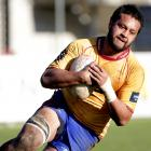 North Otago lock Pita Sinamoni heads in to score a try against Buller in their Heartland...
