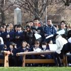 People gather in the Otago Museum reserve yesterday to commemorate the bombing of the Japanese...