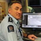 Inspector Mike Bowman checks the quality of CCTV cameras overlooking Invercargill's CBD yesterday...