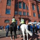 Mounted police on duty at Ibrox Stadium, Glasgow. Photo: Getty Images