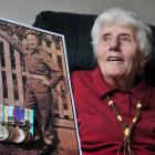 Dunedin resident Kathy Wright holds a photograph of her late brother SAS Corporal Allister (`...