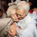 North and South Korean family members meet during a reunion at North Korea's Mount Kumgang resort...