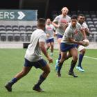 Otago first five-eighth Josh Ioane looks to move the ball on during  training at Forsyth Barr...