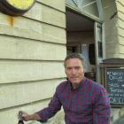 NZ Whisky Co general Manager Grant Finn outside the company's cellar door shop in Oamaru's...