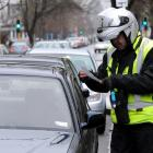 Parking officers will wear cameras and a badge from Tuesday. Photo: ODT