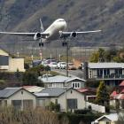 A Star Alliance aircraft takes off over Frankton from Queenstown Airport. Photo: Stephen Jaquiery
