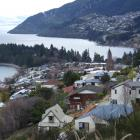 Queenstown volumes and values down; view of Queenstown Hill, foreground, Queenstown Bay and the...